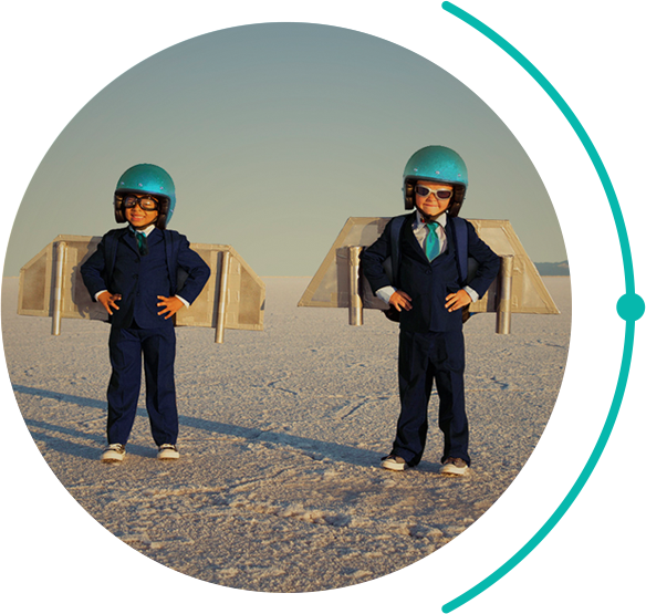 two kids lifting off the ground while wearing jetpacks